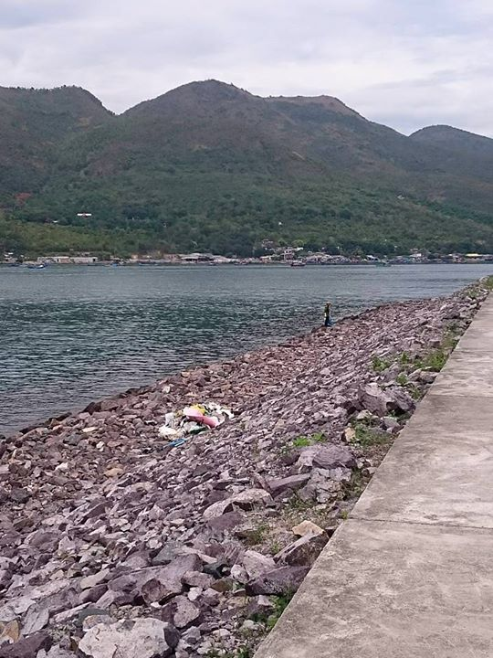 Staff cleaning up the shore of Nha Trang
